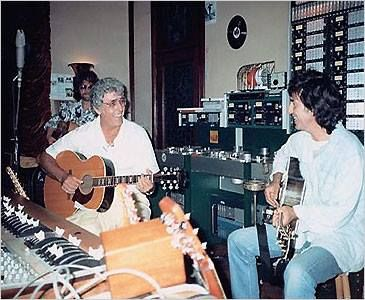 George Harrison & hero, legendary Carl Perkins --Jeff Lynne is pictured in the back