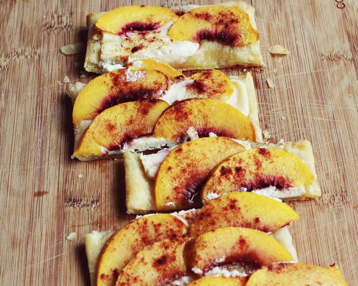 peaches and cream tart...half a sheet of puff pastry, layered with cream cheese, fresh peach slices and then generously sprinkled with cinnamon and sugar. Bake at 375 F for 18-20 minutes.