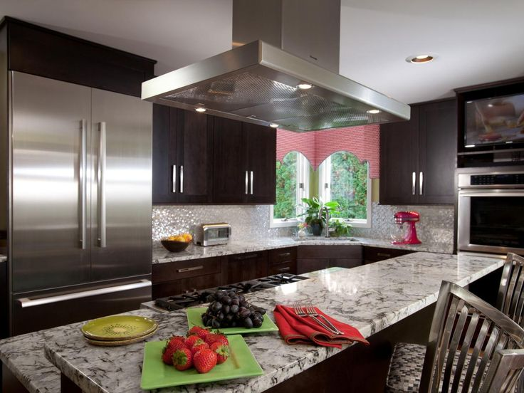 This transitional kitchen has it all with top-of-the-line stainless steel appliances, granite countertops, a breakfast bar and a TV over the oven. Color is easily added and changed through window treatments and accessories.