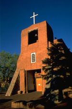 The Chapel of San Miguel is the oldest church in Santa Fe, NM. At Old Santa Fe Trail and De Vargas streets, about two blocks from the state capitol, San Miguel was originally built in 1626, although nothing of that building remains. The chapel's sculpture of San Miguel, the church's patron, was carved in Mexico in 1709. In 1710, the chapel was completely rebuilt.