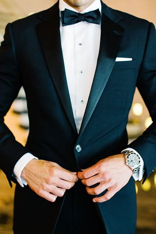 BLACK TIE WEDDING   What guy doesn't look elegant in a tux? For the ultimate black-tie vibe, go for midnight blue, it's richer than black, with of-the-moment peaked lapels and a two-button closure. To give him that James Bond-vibe, add a classic watch, chic cufflinks, and traditional black shoes.