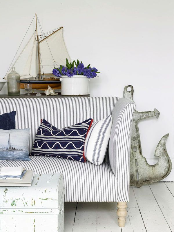 Miniature boat? Check. Stripey soft furnishings? Check. Anchor accessory? Check. This corner of the living room has all things nautical covered! #hotlooks