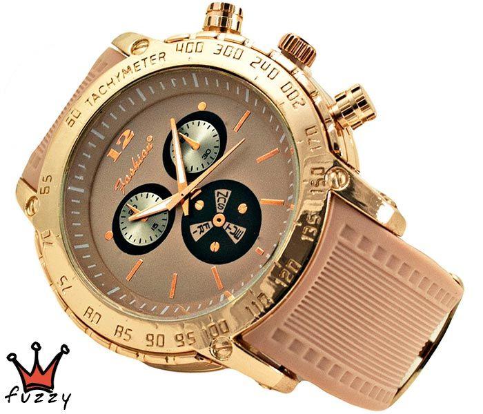 Γυναικείο ρολόι σε ροζ χρυσό και ροζ/μπεζ και μοντέρνα γραμμή στο εσωτερικό του. Λουράκι σε ροζ/μπεζ χρώμα από σιλικόνη. Διάμετρος καντράν 48 mm.