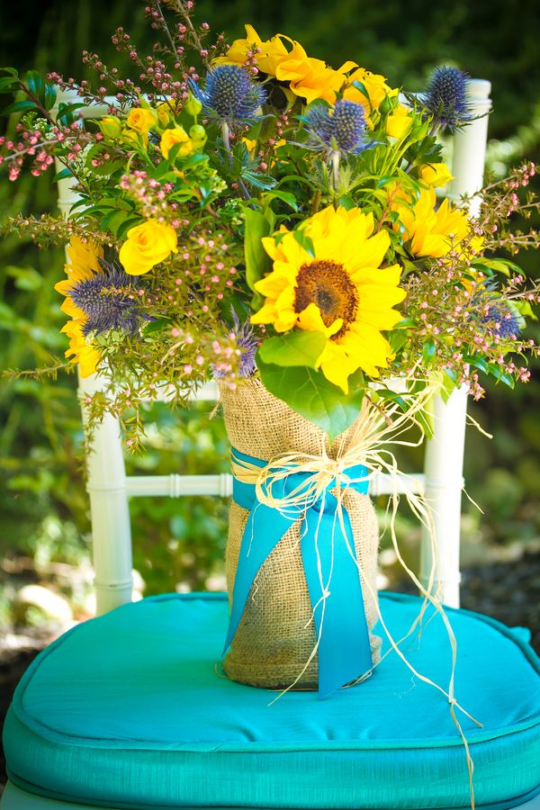 Country chic sunflower bouquet wrapped in burlap with bright blue ribbon - i love that color combo