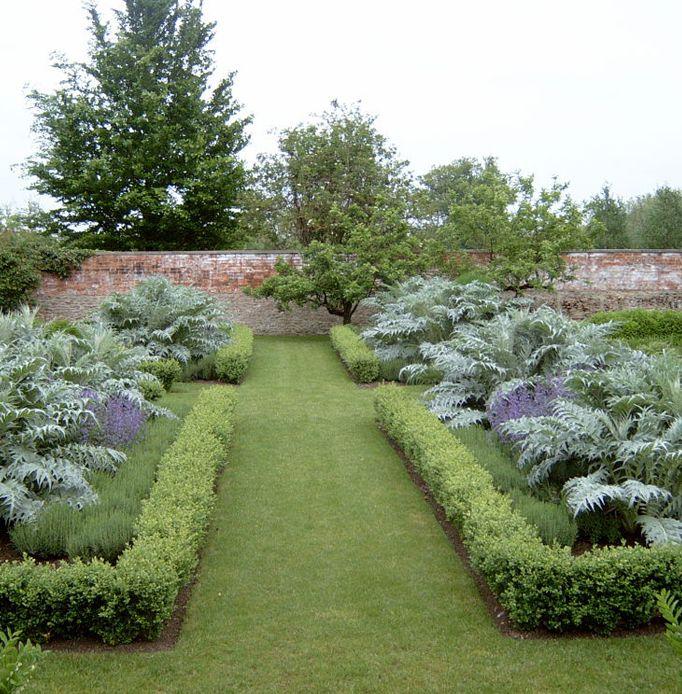Walled herb garden by nicholssongardendesign
