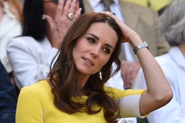 Kate Middleton Photos Photos - Britain's Catherine, Duchess of Cambridge (C) takes her seat in the royal box on centre court to watch the women's semi-final match between US player Serena Williams and Russia's Elena Vesnina on the eleventh day of the 2016 Wimbledon Championships at The All England Lawn Tennis Club in Wimbledon, southwest London, on July 7, 2016. / AFP / GLYN KIRK / RESTRICTED TO EDITORIAL USE - Day Ten: The Championships - Wimbledon 2016