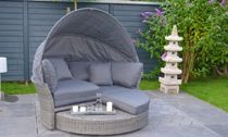 Consist Daybed with cushion Canopy Pillows Dimension Weight Colour Brown Round weave with Beige cushion pillows Material Powder-coated aluminum frame handmade 100% recycled Synthetic wicker Synthetic Wicker durable easy maintain resistant against elements