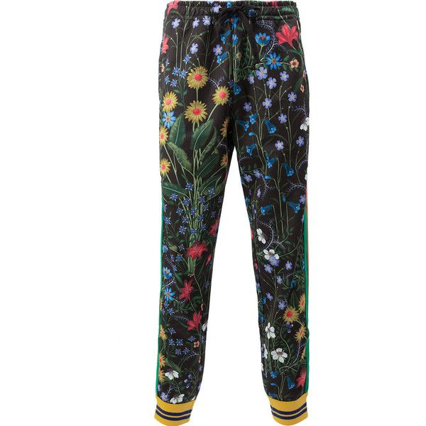 Gucci relaxed floral trousers ($1,200) ❤ liked on Polyvore featuring men's fashion, men's clothing, men's pants, men's casual pants, black, mens elastic waistband pants, mens elastic waist pants, mens stretch waist pants, gucci mens pants and mens floral print pants