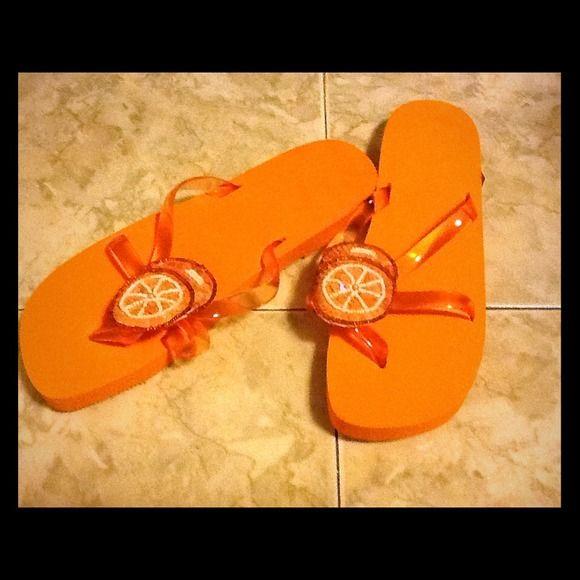 Orange Flip Flops with Sequin Oranges on Top Orange Flip Flops with sequins oranges on top. Plastic straps.  NWOT sandals Shoes