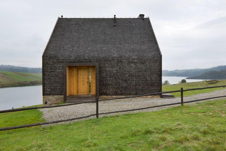 HOLA Design builds gabled lakeside cottage in Poland