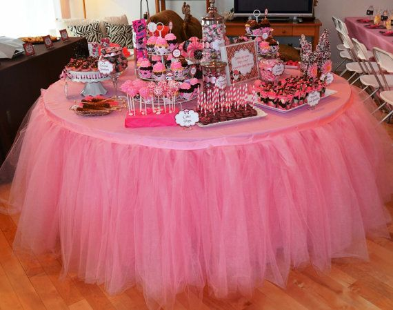 Tutu Table Skirt: This wedding cake table is made all the more special with a pink tulle table skirt @Estefania Portillo Rubianogroot lol maybe?
