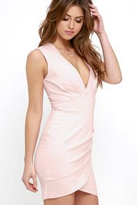 It's time to slip into the Cocktail Hour Blush Pink Wrap Dress and order your favorite thing to sip on! Sleeveless bodice has a subtle surplice neckline and pleating above a fitted skirt with wrap detail, in a medium-weight knit fabric. Hidden back zipper.