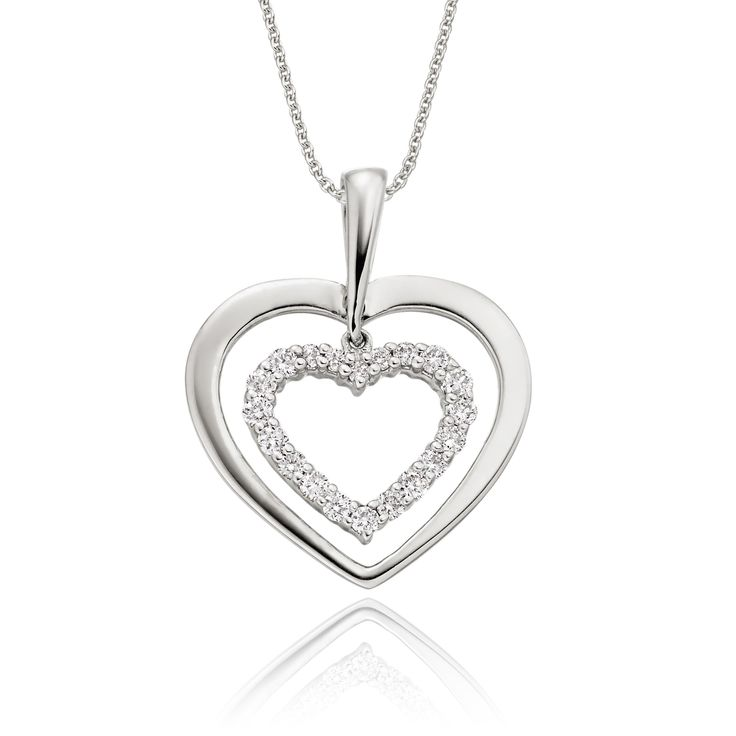 This elegant white gold diamond pendant has 0.23ct diamonds. The pendant features two carved hearts one beautifully polished and the other encrusted with round brilliant cut diamonds. This necklace is made in 9K white gold and is available complete with a beautiful mirror trace chain or if you already have a chain then you have the option to buy just the pendant.