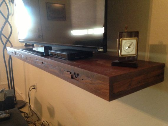 This shelf is 11 inches deep and 60 inches long 4 inches tall,this shelf is made of pine.  the shelf has special walnut stain ,a 55 inch tv is on it