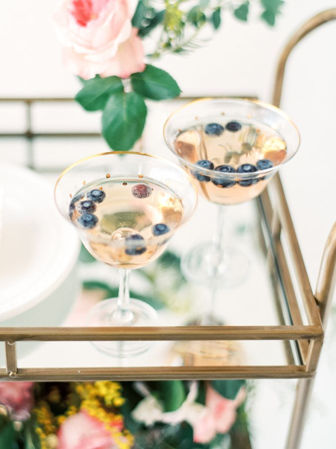 Blueberry rose cocktail: http://www.stylemepretty.com/living/2016/05/02/the-prettiest-ever-mothers-day-bar-cart-blueberry-rose-cocktail/ Photography: Divya Pande - http://divyapande.com/life/