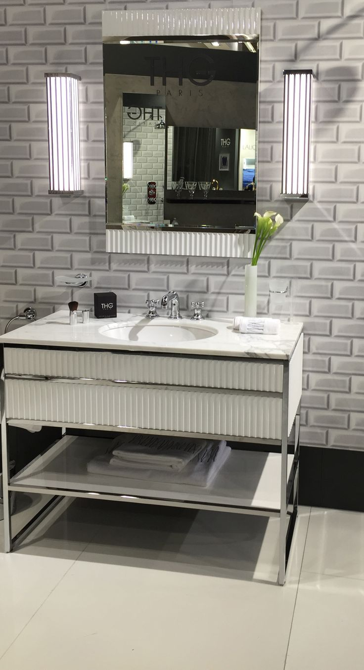 Academy consolle in glossy white finish with ribbed decoration and chrome finish details. Designed by Massimiliano Raggi