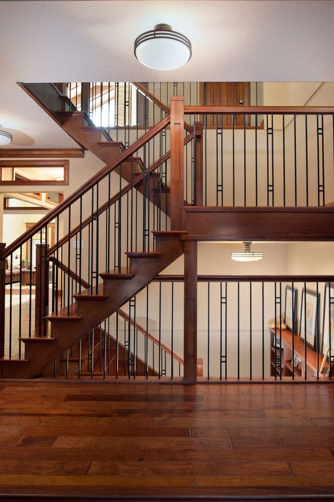 Stunning Wrought Iron Balusters Gallery Image Decor in Staircase Craftsman design ideas with Stunning ceiling lighting decorative railing landing metal railing wood floors wood treads
