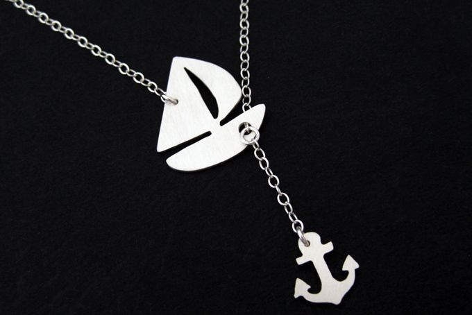 Anchors Up!This sailboat and tiny anchor are hand cut by me from a sheet of sterling silver with a small hand held jewellers saw. For sale on http://hellopretty.co.za