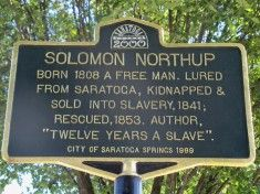 July 1808 | SOLOMON NORTHUP (MEMOIR: 12 YEARS A SLAVE), an accomplished violinist and inventor, was born a free man in Minerva, New York. Mr. Northup lived and worked in Saratoga Springs with his family for part of his life. He worked at the landmark Grand Union Hotel as well as other hotels as a cabbie and violinist. Solomon was abducted in 1841, held in a slave pen in Washington, DC, and sold into slavery in Louisiana for 12 years.