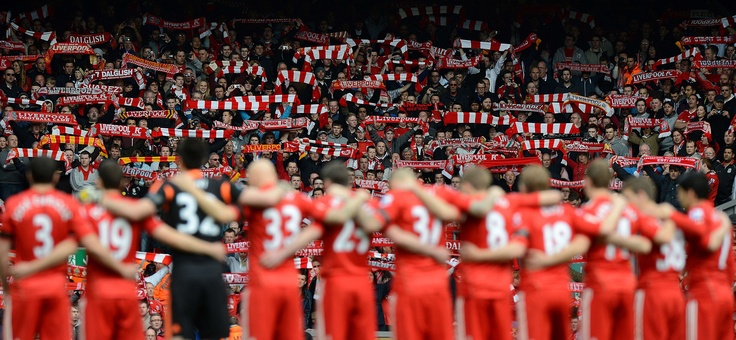 Liverpool players and fans during a minute's silence to mark the 23rd anniversary of the Hillsborough disaster.