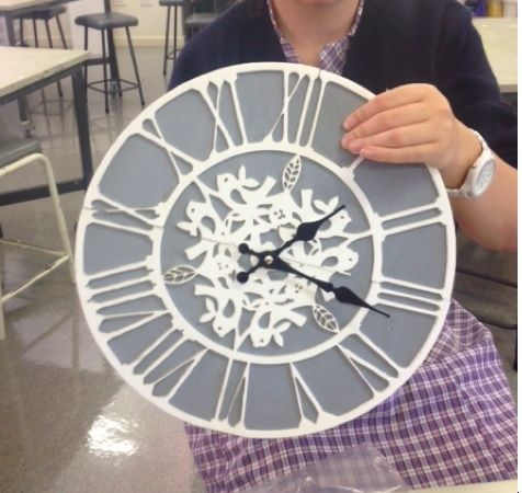 The laser cut clock created from the adobe illustrator vector image.