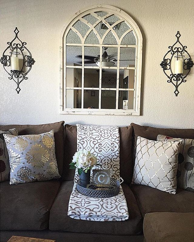 There is so much beautiful #symmetry in this photo of @liv3rpool87's home, all centered around our Distressed Cream Sadie Arch Mirror! It's one of our most popular items, so click the link in our profile to buy yours before it sells out! #myKirklands #walldecor #mirrors #livingroom