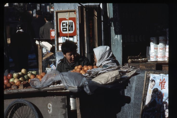 https://flic.kr/p/7vCVUP | Seoul, Feb 1966 | Fruit vendor. Tobacco store in background.