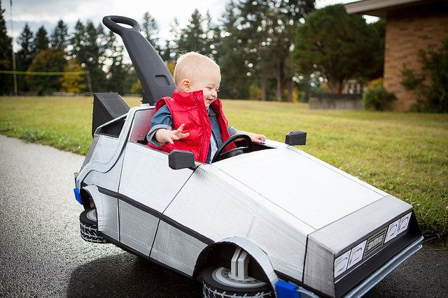 Kid's Push-Cart Modded Into Time-Traveling DeLorean - This is lil Cooper's first Halloween. And he is gonna be trick or treating IN STYLE thanks to his father Cody modding his push-cart into the time-traveling DeLorean from 'Back to the Future'.