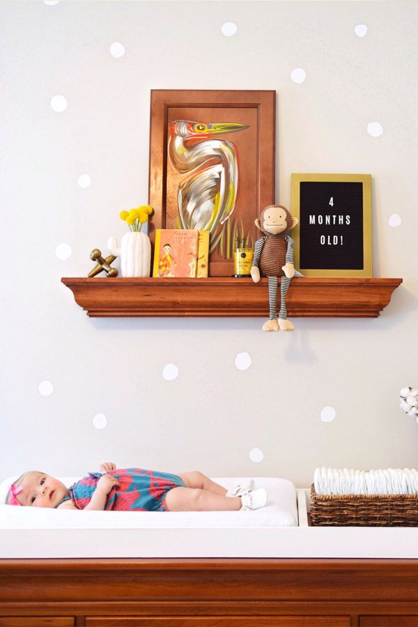 These white polka dots look great on a dark wall. Nursery wall decals are an easy way to update your kid's rooms. #wallstickers #walldecals #dots #nurserydecor