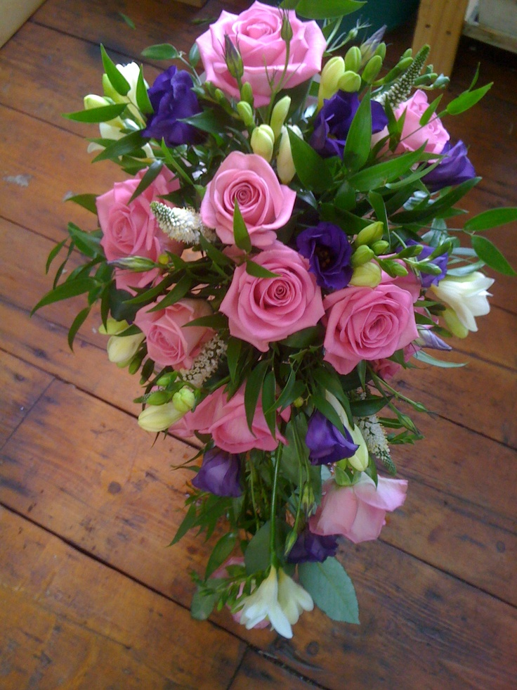 Cascading Wedding Bouquet Showcasing: Pink Roses, Purple Lisianthus, White Freesia, White Veronica & Greenery/Foliage