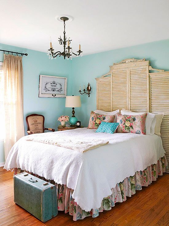 Turn old architectural elements into a stunning headboard. In this cottage bedroom, pairs of shutters topped with decorative moldings do the trick. Shutters, paneling, and other elements can be quite heavy -- be sure to install your finds securely to the wall.