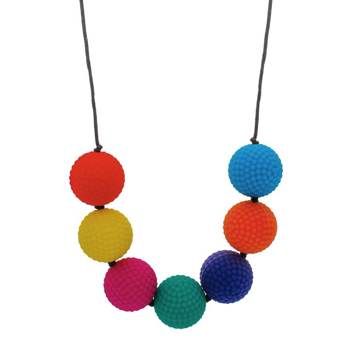 """Sing it with me... """"Red and Yellow and Pink and Green, Purple and Orange and Blue... """" Learn the rainbow song with this delightful necklace. Soft nubs for sensory play. Drop 40cm, bead size 28mm."""