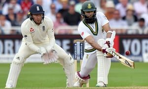 South Africa's Hashim Amla sweeps on the third day of the second Test, watched by England's Jonny Bairstow who failed to review a catching chance early in the day.