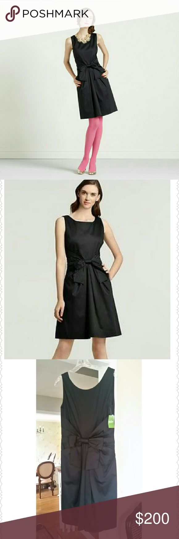 Kate Spade  Jillian Dress in Black Channel Audrey Hepburn and Jackie O in this timeless LBD!  This sweet, feminine frock is fashioned of cotton with a boatneck front and a low scooped back. Pleating at the waist is topped with a dramatic bow, lending waist-whittling definition before descending into a full skirt with kangaroo pockets-perfect for easy access to lipstick or a little cash to fix your lips or buy a  cocktail. 98% Cotton 2% lycra.  Fitted waist defined by pleats; full skirt and…