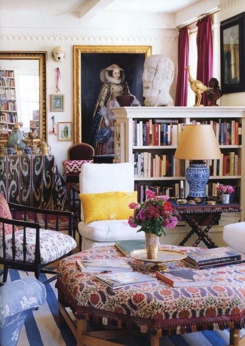 Room of the Day: fell in love with this original room first time I saw it in Annie Kelly's book ROOMS TO INSPIRE IN THE CITY.  Love the fabrics, colors, large picture of a 16th century woman, the oversize ottoman, books galore, striped rug - one of my favorite rooms of all...designer Carolina Irving. 6.9.2013