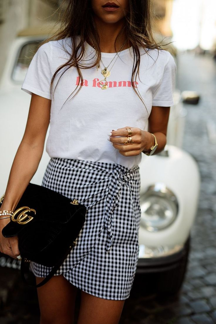 Feminist 'La Femme' tshirt, gingham skirt, and gucci marmont bag. See what fashion girls are buying this week