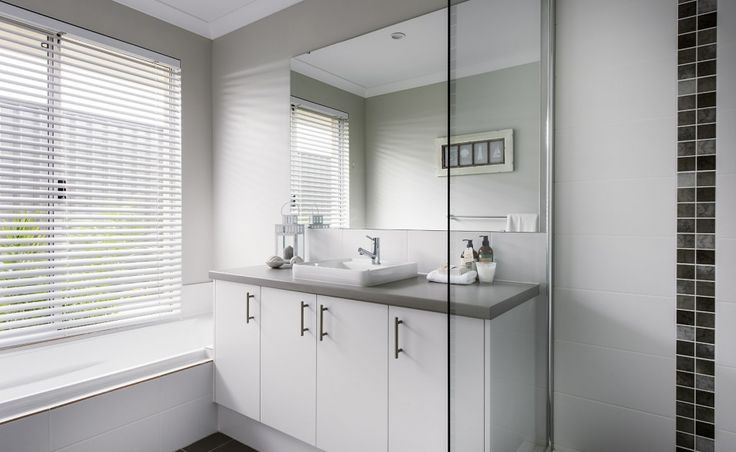 Stylish bathrooms with semi-inset vanity basins and glass semi-frameless pivot screen shower doors