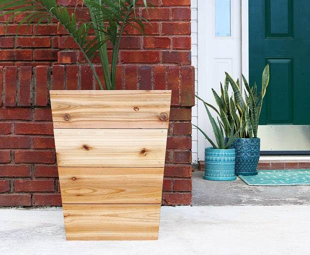 best interior design blogs raw wooden planter outside
