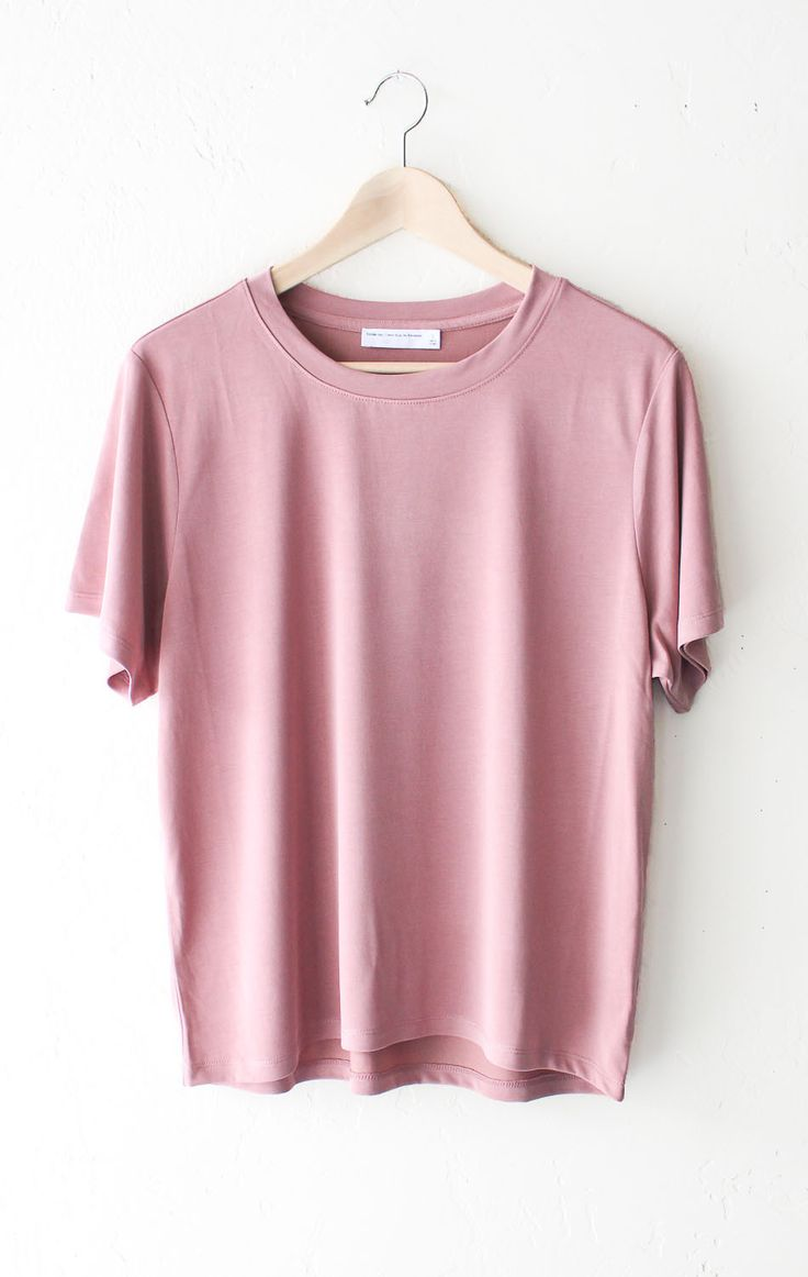 """- Description Details: Soft & relaxed basic tee in vintage rose. Relaxed fit. Measurements (Size Guide): S: 44"""" waist, 23.5"""" length M: 46"""" waist, 24.0"""" length L: 48"""" waist, 24.5"""" length 64% Modal, 36%"""
