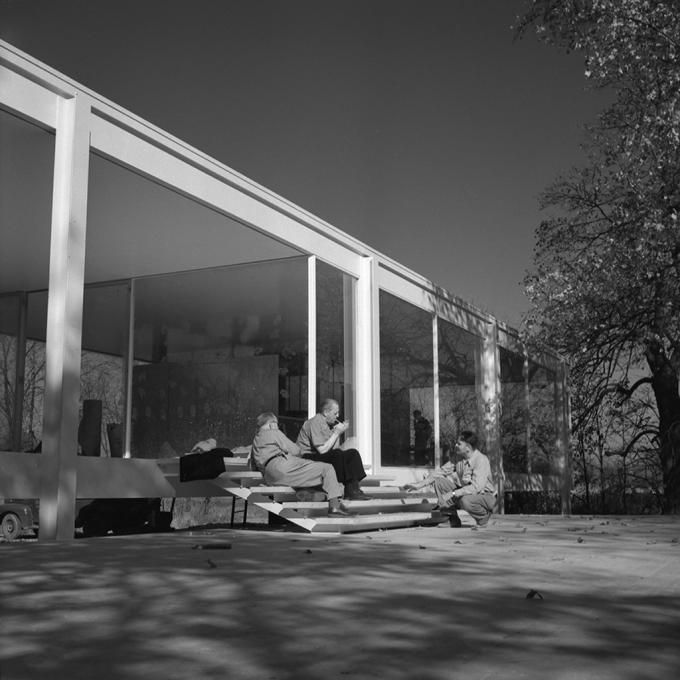 Mies van der Rohe smoking a cigar on the Farnsworth House stairs. Click for larger image.