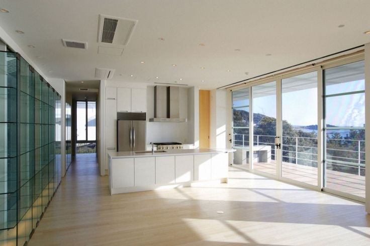 Architecture, Lovable Open Plan Kitchen Design With Woods And White Tones Concept White Wooden Kitchen Set With Steel Built In Hood And White Wooden Countertop Transparent Clear Glass Wall With Natural Surrounding Outside: Modern Villa Design Encompassing the Brightness and Airy Atmosphere