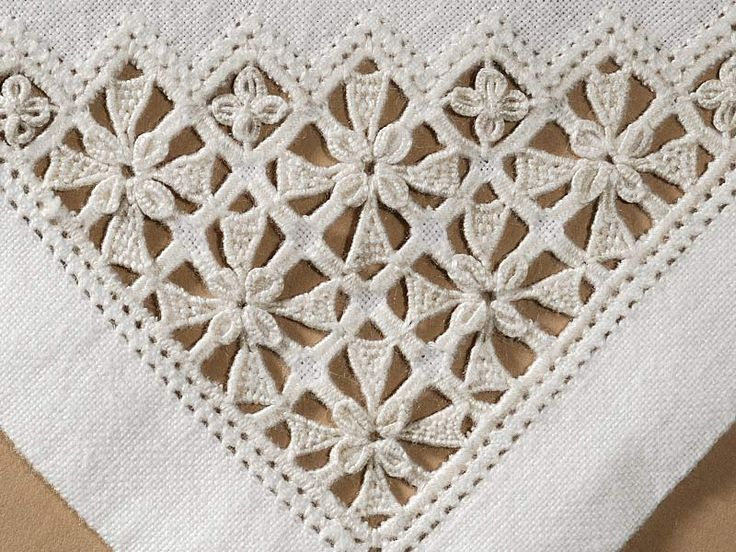 Reticello flower corner - Reticella - embroidery and lace is a needle lace dating from 15th century and was popular into the first quater of 17th century. Reticella was originaly a form of CUTWORK. Later reticella used a grid made of thread rather than a fabric ground. Both metods resulted in a characteristic design of squers and circles with arched and scalloped borders. Reticella developed in PUNTO IN AREA.
