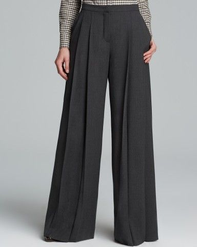 Weekend Max Mara amplifies the drama of wide-leg trousers with an extra exaggerated and pleated silhouette.   * Virgin wool/elastane  * Dry clean  * Imported  * Zip fly with button closure, front pleats  * Two slit front and two button slit back pockets, wide legs  * Please refer to our Contemporary size chart  * Please order your US size above. Note: For those familiar with Weekend Max Mara's Italian sizing, here is the conversion: 36=2; 38=4; 40=6; 42=8; 44=10; 46=12; 48=14; 50=16  * Web…