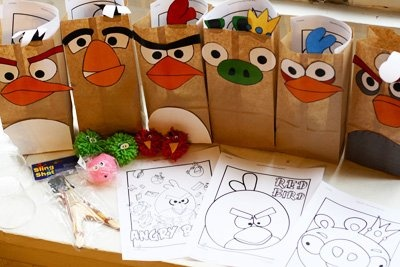 Angry Birds Birthday Party Goodie Bags.  ***print out coloring sheets, cut and attach to bags and put crayons in bag, kiddos could color bags after getting home and taking goodies out....