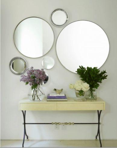 Composição de espelhos na parede