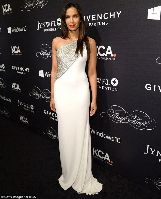 A stunning sight: The Top Chef star looked radiant in a white gown with silver sequined de...