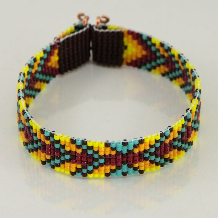 Native American Style Chevron Bead Loom Bracelet Artisanal Jewelry Indian Western Beaded Gypsy Boho Bohemian Turquoise Red Yellow Orange by PuebloAndCo on Etsy https://www.etsy.com/listing/217497821/native-american-style-chevron-bead-loom