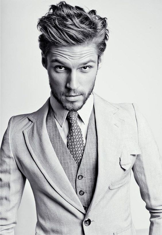 Men in suit with messy hair