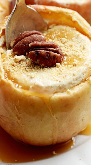 Cheesecake Stuffed Baked Apples ~  The only thing better than a juicy harvest apple is a baked apple filled with rich cheesecake!  Top it off with caramel sauce, graham cracker crumbs, and pecans for the ultimate no-fuss Autumn dessert!