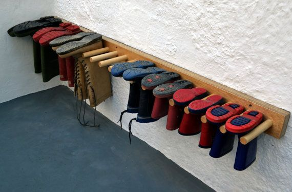 Space saving boot rack, made from Birch Plywood. Finished in hard wearing Danish Oil.  Handy for drying soggy / dirty boots.